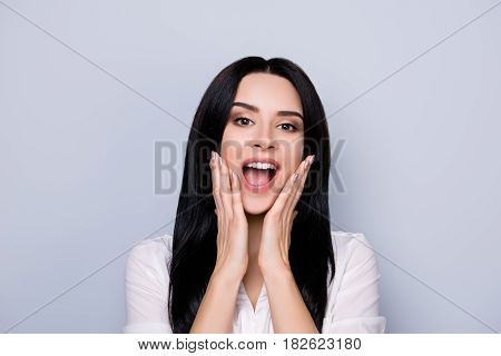 Wow. Close Up Portrait Of Beautiful Cute Excited Young  Woman With Surprise Open Mouth And Touch Fac
