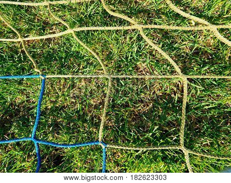 soccer ball green grass field soccer line. Hang bended blue yellow soccer nets soccer football net.
