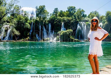 Girl in White Dress near Kravice Waterfall Bosnia and Herzegovina