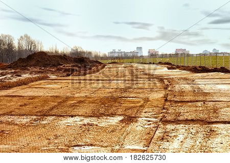The texture of the mud or wet soil.Road to build a house