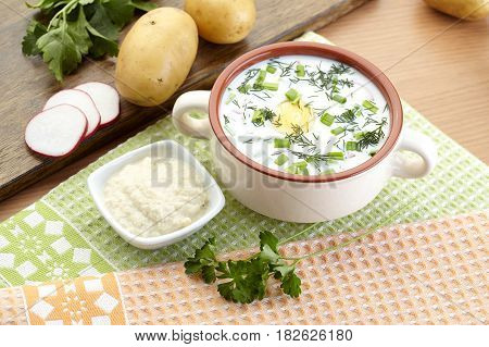 Cold yogurt soup with dill and yolk, russian traditional dish - okroshka
