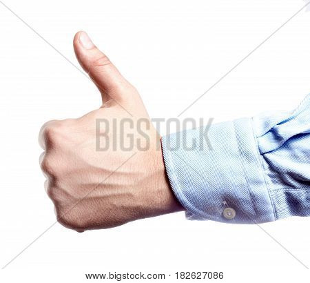 Man's hand isolated on white. Thumb up.