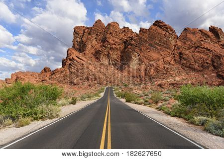 Desert Highway with Yellow Lines on Sunny Day