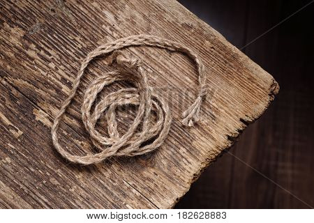 Woven rope on an old wooden table decor