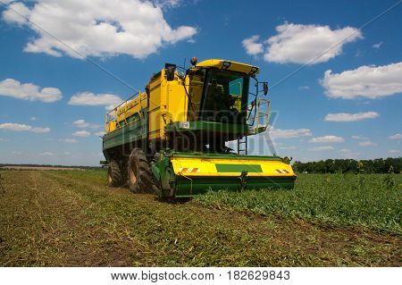 Combine harvester working on the harvest in a field.