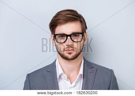 Portrait Of Serious Young Man In Glasses Looking Straight In Camera With Deep Glance In Formal Cloth