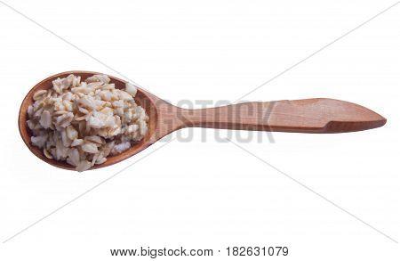 Spoon of oats porridge on a white background.