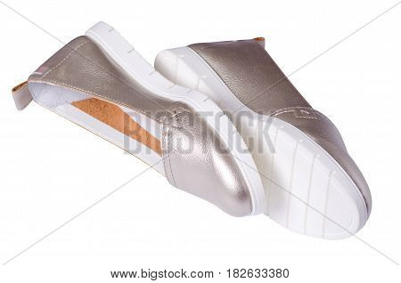 Women's shoes silver on the white soles isolated