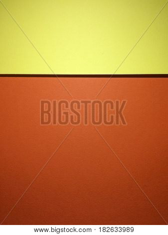 Two colors tone textured papers abstract background with copy space. Orange and yellow version. Rule of thirds used.