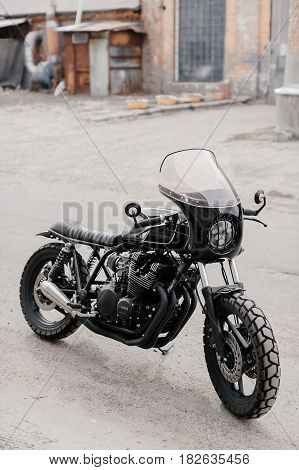 Motorcycle kaferacers. Black motorcycle on the street. Motorcycle for two people