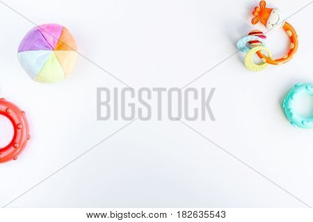 Baby accessories and toys set on white background top view mock up