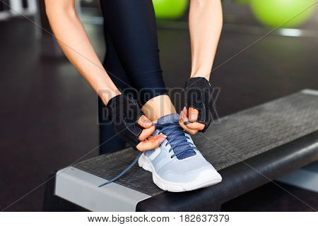Woman getting ready to workout at the gym
