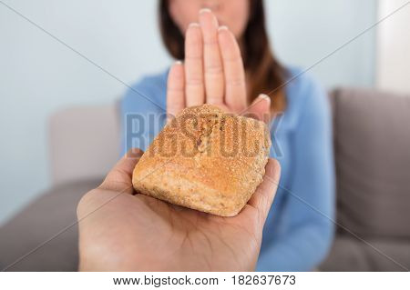 Close-up Photo Of A Woman Rejecting Bread