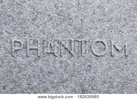 Word Of The Phantom On A Gray Foam
