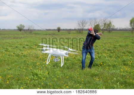 A Man Hides Himself From A Collision With A Drone. Quadrocopter Flies To The Person