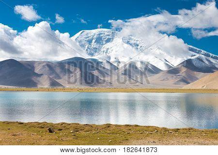 Xinjiang, China - May 21 2015: Karakul Lake. A Famous Landscape On The Karakoram Highway In Pamir Mo