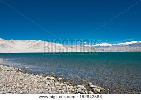 Xinjiang, China - May 22 2015: Lake View From Karakoram Highway. A Famous Landscape On The Karakoram