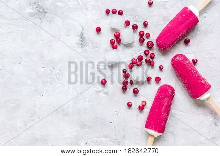 homemade ice-cream with cowberry on stone kitchen table background top view space for text