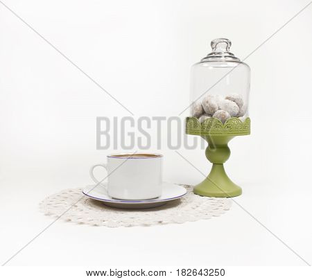 Turkish coffee on lace work with cookie jar