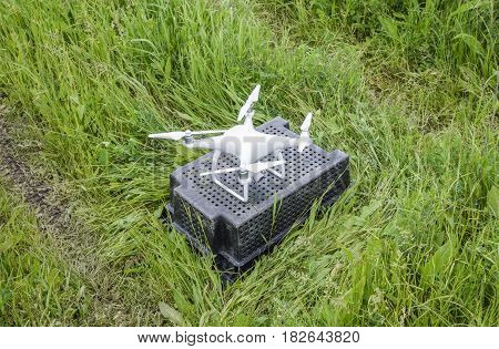 Quadrocopters On A Plastic Box In The Grass