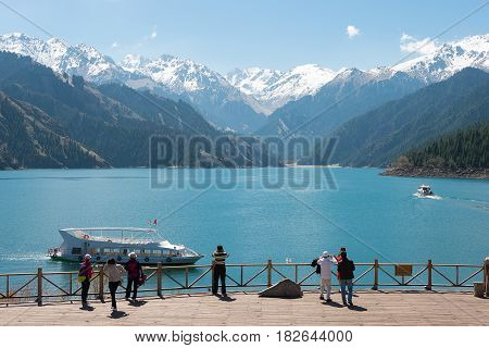 Xinjiang, China - May 09 2015: Heaven Lake Of Tian Shan(tianchi). A Famous World Heritage Site In Fu