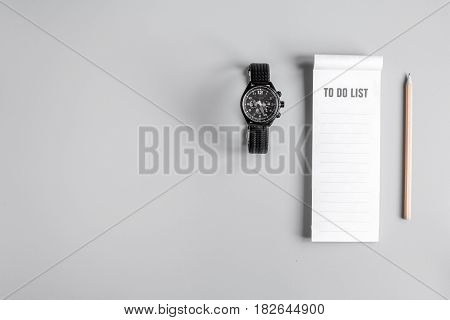 workplace in office with business plan development with to do list on gray desk background top view space for text