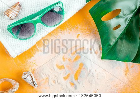 Cosmetic bottle with cream for sun protection on orange background top view mockup
