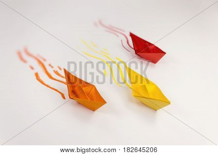 3 piece paper ships and waves. Leadership concept