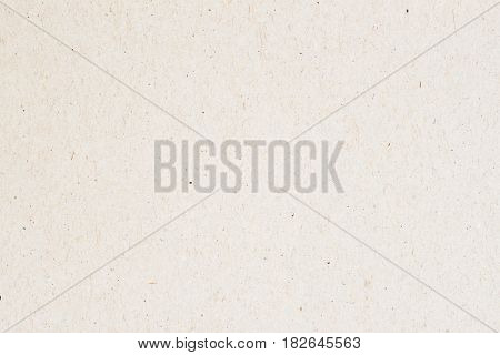 Texture of Natural rough paper, background for design with copy space text or image. Recyclable material, has small inclusions of cellulose