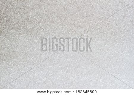 Texture of thermal insulating styrofoam close-up, light grey tone. Structure polystyrene plastic. For background, design with copy space text or image