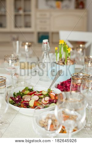 Beautifully decorated table with a focus on appetizing salad