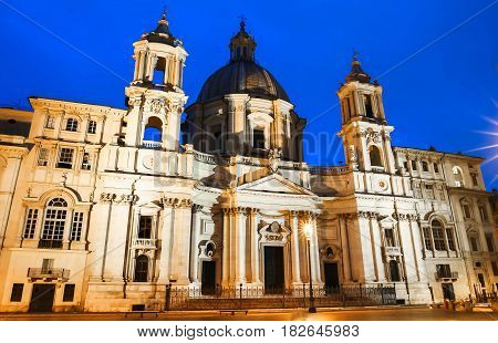 The church on Piazza Navona at night Rome Italy