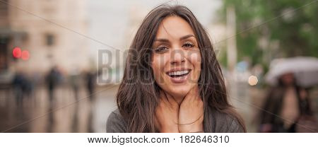 Happy Cheerful Smiling Woman Enjoy On The City Streets