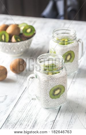 Chia seed puddings with kiwifruit slices on the wooden table