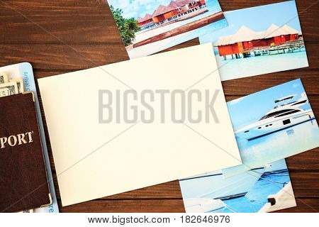 Travel concept. Blank notepad page with space for text and passport on wooden background
