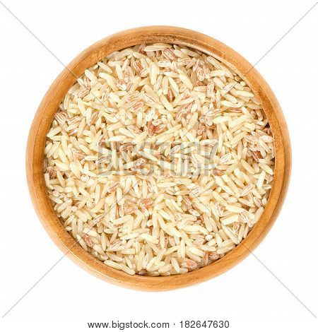 Sparkling Volcano Terra rice in wooden bowl. Brown, red and pink natural rice. Rice of warriors from Tasikmalaja region of West Java. Isolated macro food photo close up from above on white background.
