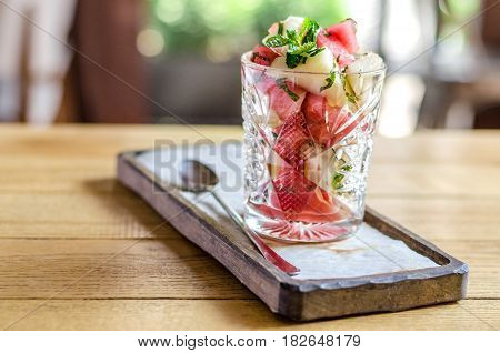 Healthy Food. Dietary Salad From Watermelon And Melon With Mint, In A Glass, On A Wooden Stand