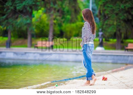 Young happy woman walking at warm autumn day