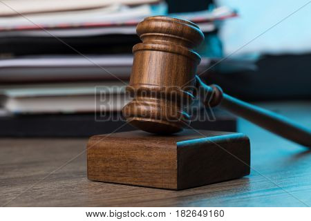 Wooden table with hammer, documents