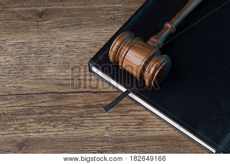Judge's hammer on black folder