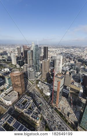 Aerial view of downtown Los Angeles towers and the Harbor 110 freeway in Southern California.