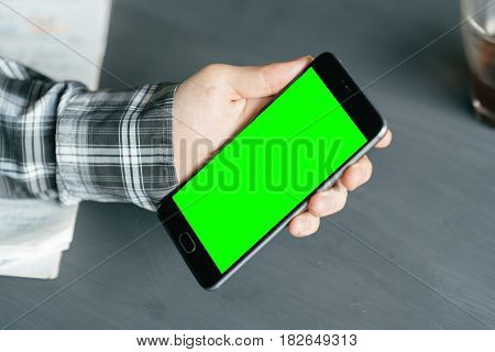 Business man using smart phone with green screen for internet and email. Sequence Concepts of using mobile technologies and smarfon in mobile applications in daily communication