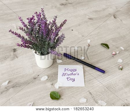 Mothers day card with flowers on wooden board