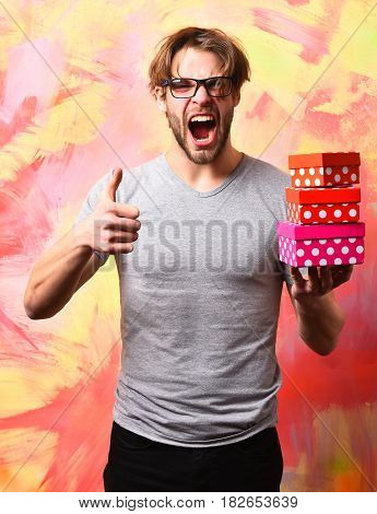 Caucasian Bearded Sexy Macho Man Holding Gift Boxes
