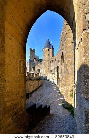 Medieval Castle Of Carcassonne Viewed Through An Arched Gate, France