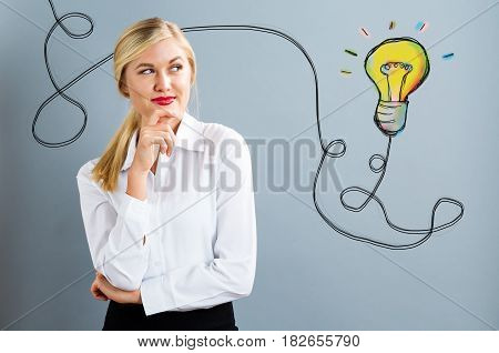 Light Bulb With Young Business Woman
