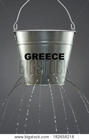 Bucket of water with a big leak and the text saying Greece