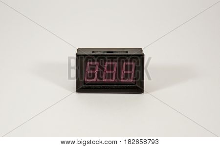 A Small Digital Indicator Is A Voltmeter-ammeter With Colored Wires.