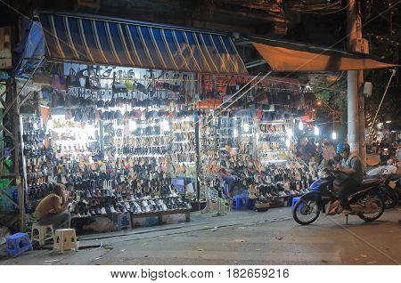 HANOI VIETNAM - NOVEMBER 23, 2016: Unidentified people visit a shoe shop in Old Quarter.