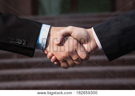 Business agreement sign. Handshake on background Bank. Shake hands sign with each other. Friendship partners sign. Sign concept